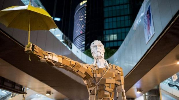 Symbol of defiance: The Umbrella Man statue outside the central government offices in Hong Kong.