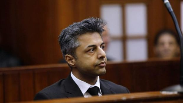 Shrien Dewani sits in the dock before the start of his trial in Cape Town.