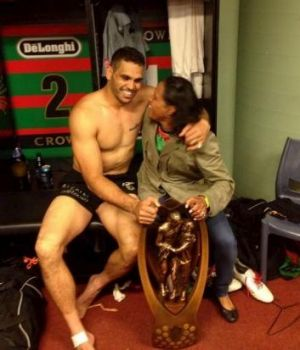 Inspirational: Cathy Freeman joins Greg Inlis with the NRL trophy in the South Sydney dressing room.