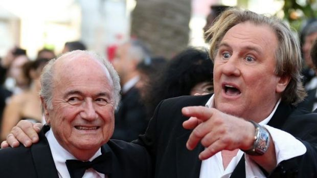 Gerard Depardieu (R) arrives at the Cannes Film Festival.