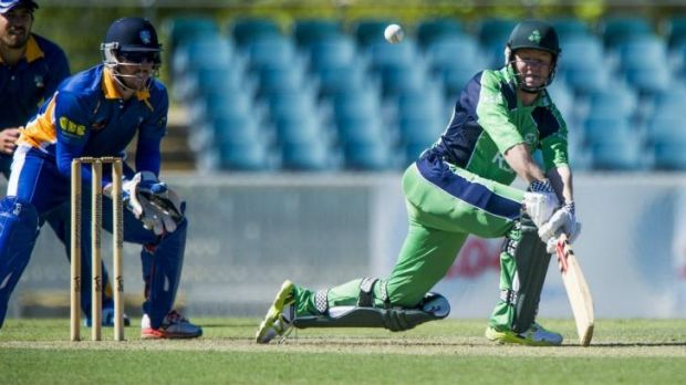 Nial O'Brien of Ireland plays a sweep shot against the ACT Comets at Manuka Oval.