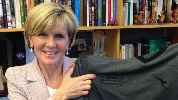 Personal PJs: Julie Bishop shows off her monogrammed Qantas pyjamas.