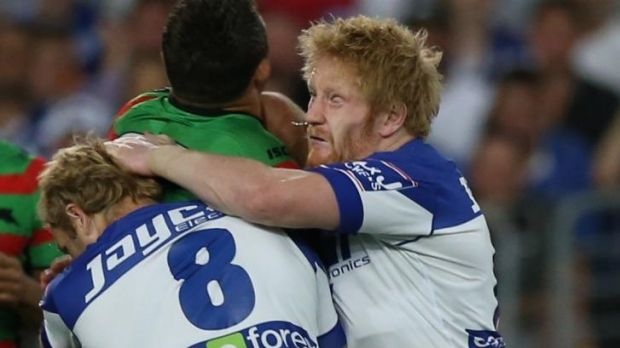 Point of impact: Sam Burgess' face meets James Graham's head.