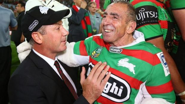 Red and green journey: Peter Holmes a Court (left) celebrates with the Rabbitohs' mascot after Sunday's grand final win.