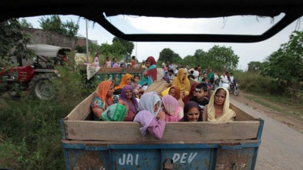 Fleeing: Indian villagers prepare to leave the disputed region of Kashmir after a cross-border exchange between Indian ...