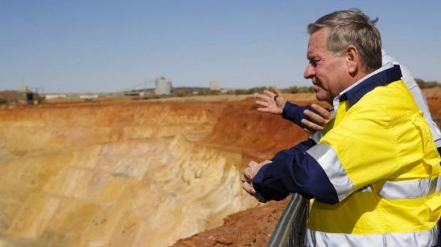 WA Premier Colin Barnett has fired a shot across the bows of mining giants Rio Tinto and BHP Billiton.