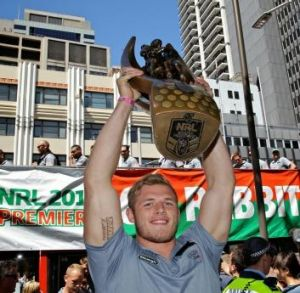 Tom Burgess holds the trophy high.