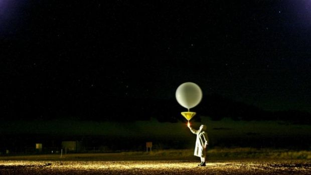 Weather observer: Michael Glasson releases a weather balloon at Giles weather station in Western Australia to track wind ...