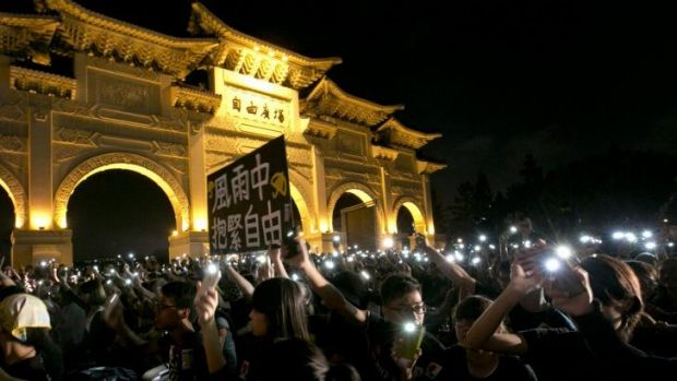 Cell phone showing: A rally in Taipei to show support for Hong Kong pro-democracy protests.