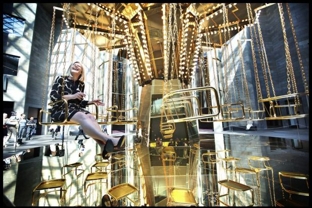 Melbourne Festival Director Josephine Ridge sitting on the newly installed Mirror Carousel by commissioned artist ...