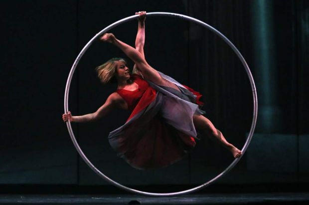Performer Lea Toran Jenner balances inside a spinning hoop during a dress rehearsal for the Canadian acrobatic troupe ...