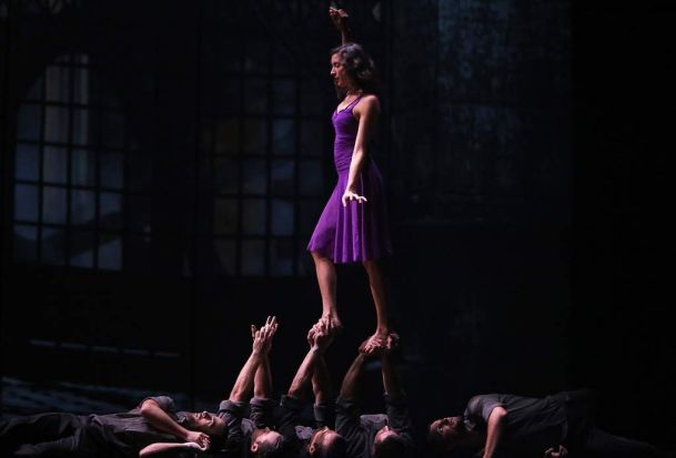 Contortionist Myriam Deraiche walks across the hands of fellow performers during a dress rehearsal for the Canadian ...