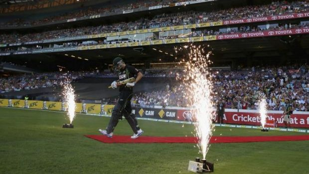 Let the fireworks begin: Cameron White heads out to bat for Australia at ANZ Stadium in February.