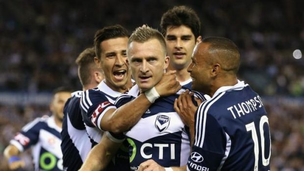 Welcome: Albanian striker Besart Berisha is mobbed by teammates after scoring Victory's second goal.