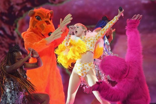 Miley had help from some colourful characters on stage.