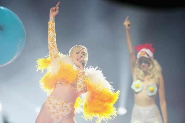 A finger in the air: Miley at Rod Laver.