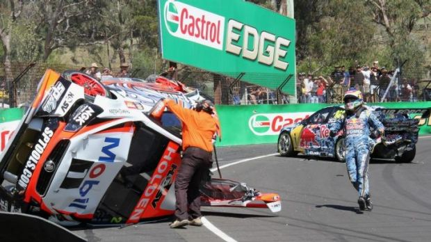 Craig Lowndes rushes to aid Warren Luff after their crash during practice at the Bathurst 1000.