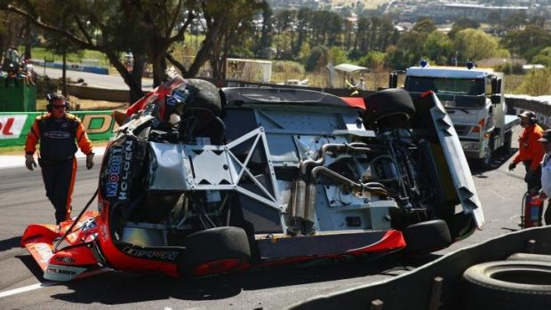 Carnage: The Mt Panorama course was littered with debris after the Lowndes-Luff crash.