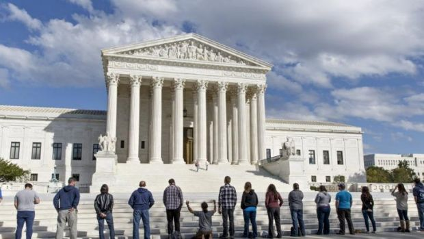 pro-life advocates hold a prayer vigil on the plaza of the high court in Washington, Saturday, Oct. 4, 2014. The group, ...