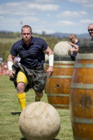 Focused: Strongman Moe Westmoreland moves in for the challenge during the Stones of Manhood competition at the Canberra ...