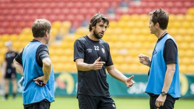 Roar star Thomas ?Broich talks to coach Mike Mulvey ahead of the team's opening A-League match at Suncorp Stadium.