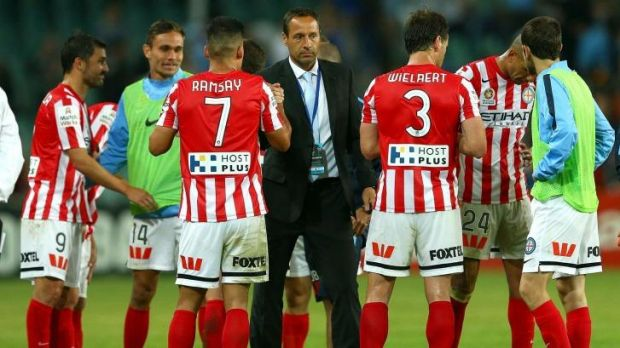 Well done, boys: Melbourne City coach John Van't Schip shakes hands with his players after the game.