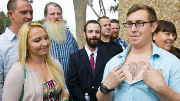 Donald Besch, 25, right, the son of Susan Mellen, shows a broken heart he had tattooed on his chest to honour her.