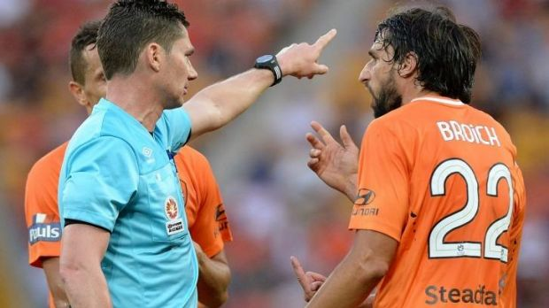 Brisbane Roar's Thomas Broich argues with the ref after Matt McKay was sent from the pitch.