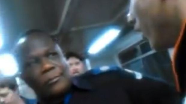 RACIST TIRADE: A screenshot from the video of a racist rant against a Queensland rail guard, pictured.