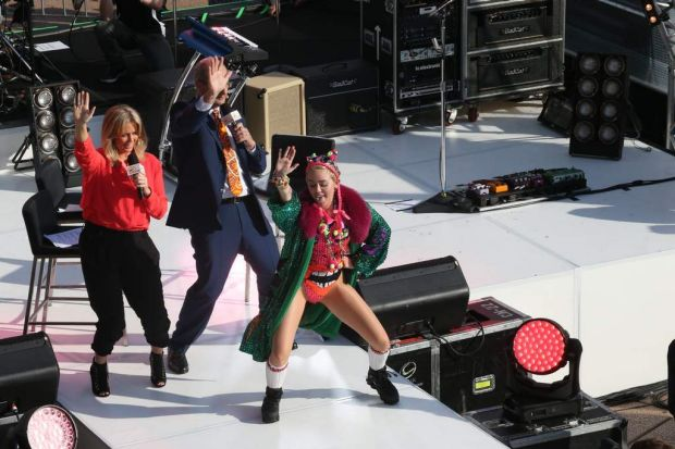 Miley Cyrus performs in Sydney. Sunrise presenters, David Koch and Samantha Armitage dance on stage with Miley.