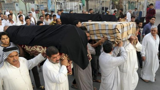 Friends and family  of victims of a suicide bombing  carry coffins during a funeral in the Shula neighborhood of Baghdad.
