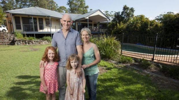 Interstate commuter Belinda Kerr at home on Queensland's Sunshine Coast with husband Michael Trehy and daughters Molly, ...
