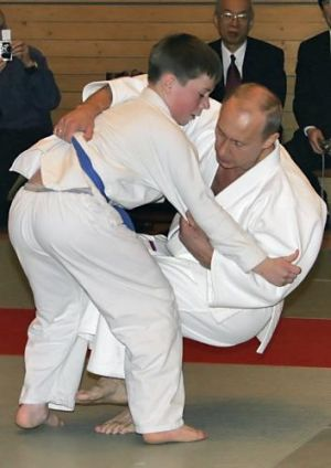 Russian President Vladimir Putin taken down by a student at a judo master class in St Petersburg.