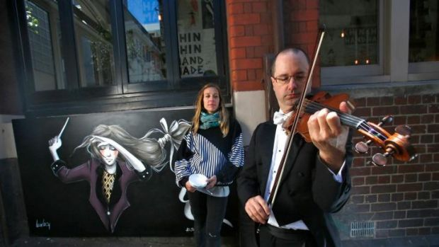 Melbourne Symphony Orchestra violinist Roger Young with artist Lucy Lucy outside restaurant Chin Chin on Tuesday.