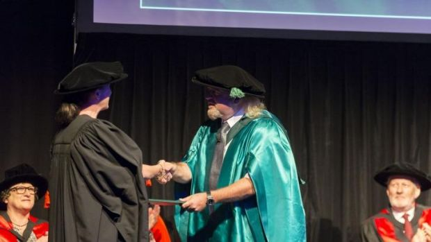 Comedian Bill Bailey receives an honorary doctorate from the University of the Sunshine Coast for his work in ...