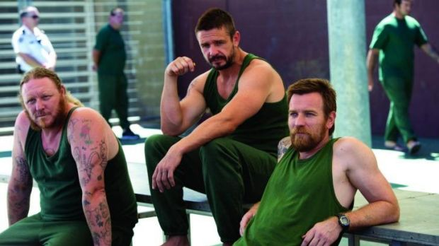 Confinement: Eddie Baroo, Matt Nable and Ewan McGregor soak up the prison atmosphere.