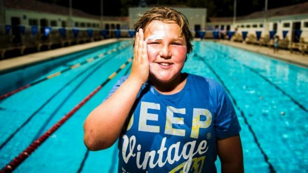 Slap it on: Dominic Cotsell, 11, from Narrabundah, puts on some sunscreen.