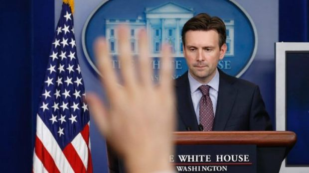 White House spokesman Josh Earnest fields a question about Ebola during a press briefing in Washington.