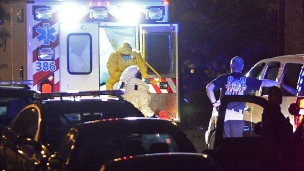 An ambulance carrying Amber Vinson, the second nurse to be diagnosed with Ebola in Texas, arrives at Emory University ...