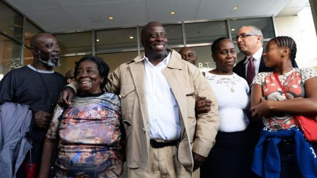 David McCallum (centre), a New Yorker who was in prison for 29 years for a murder, is surrounded by his family members ...