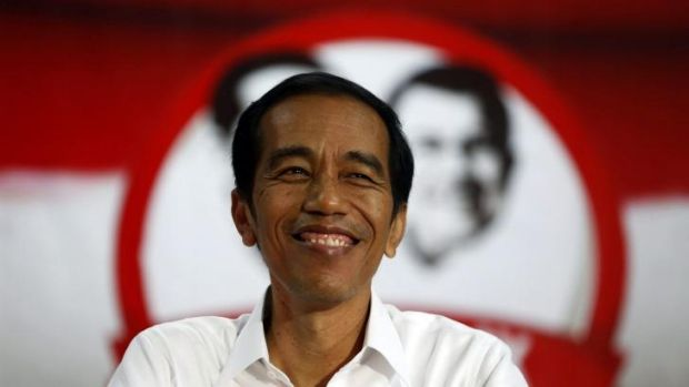 "Joko ""Jokowi"" Widodo:  Speaks in an unpolished baritone and has a wide smile."