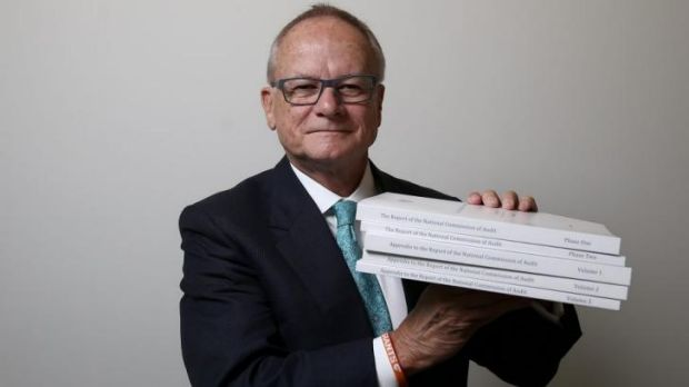 Tony Shepherd uses a Giants wristband to help him lift his audit findings.