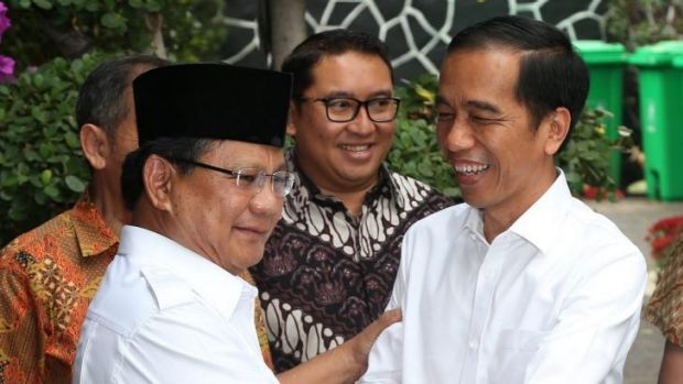 All smiles: President-elect Joko Widodo, right, shakes hands with defeated opponent and opposition leader Prabowo ...