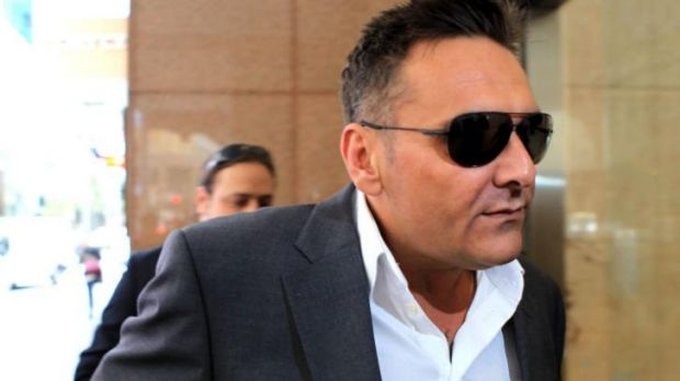 Dark glasses all round: George Alex arrives at the royal commission on Friday.