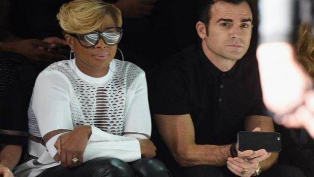 Jennifer Aniston's fiance Justin Theroux enjoying the front row at the Alexander Wang for H&M show with singer Mary J. Blige.
