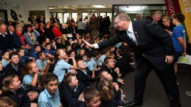Premier Denis Napthine high fives students at the opening of Woolsthorpe Primary School.