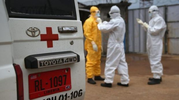 Health workers don protective clothing in Liberia.