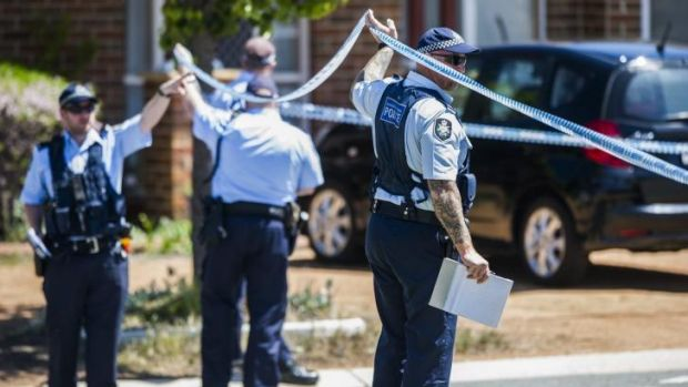 Family tragedy: Police on the scene of last night's death on Dexion Place in Dunlop.