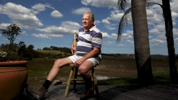 Farmer Anthony Zizza in front of his dam wall which has asbestos contaminated dirt in it, on his Mangrove Mountain ...
