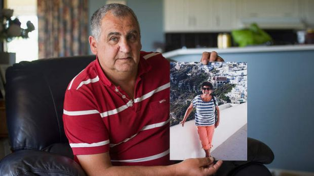 Hans Sidelik holding a photo of his sister Helena, who was killed when flight MH17 was shot down over the Ukraine.